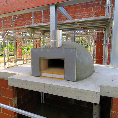 Forno wood fired oven positioned in a home